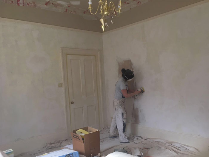 Edwardian house wallpaper preparing the walls
